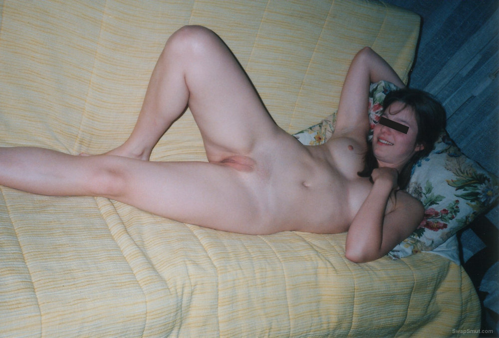 Just a hot amateur girlfriend posing naked on sofa