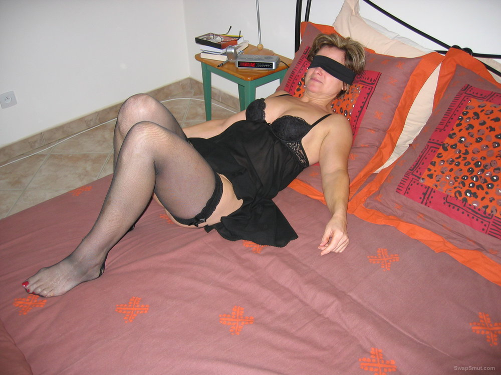 Mature woman blindfold and tied waiting for stranger to use her body
