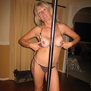 Mature blonde pole dancing strip tease