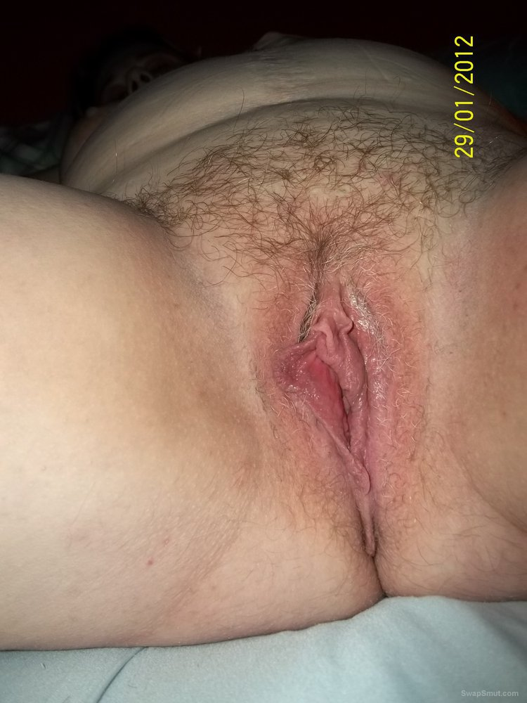 Wife playing with her pussy moist pussy after being filled with sperm