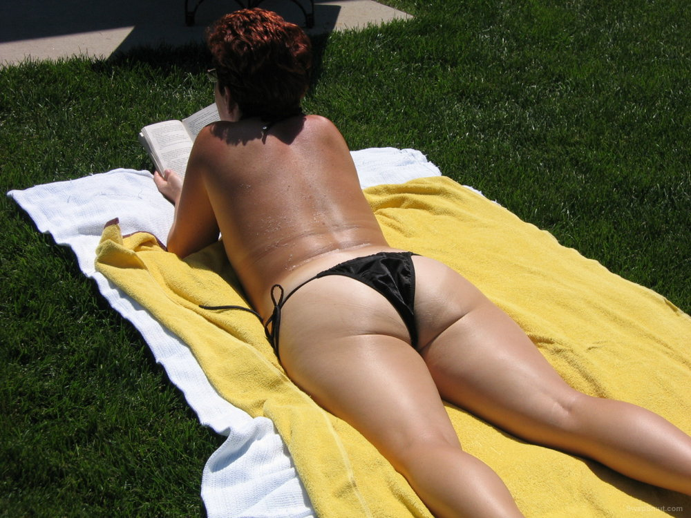 Sunbathing in the backyard minus the bikini topless and full nudity
