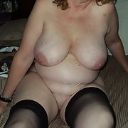 My plump milf wife strips for pics and poses