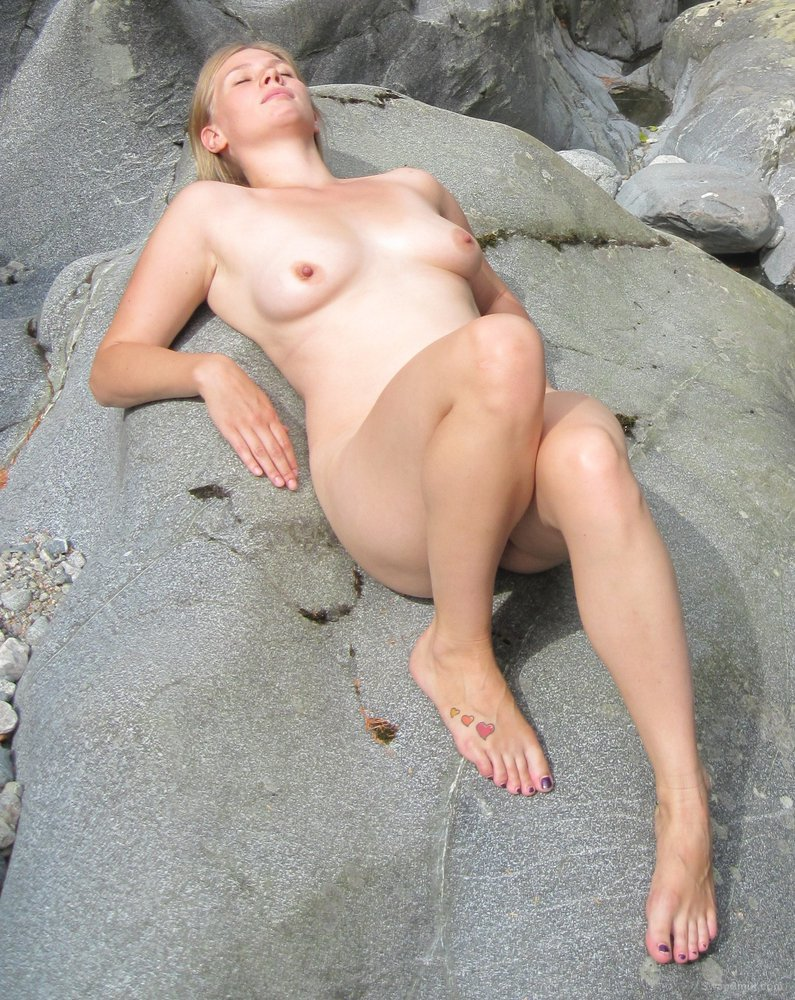 my oldest sexy friend posing for nude photos by a river