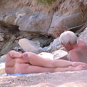 Spy party Russian mature couple at the public beach tanning