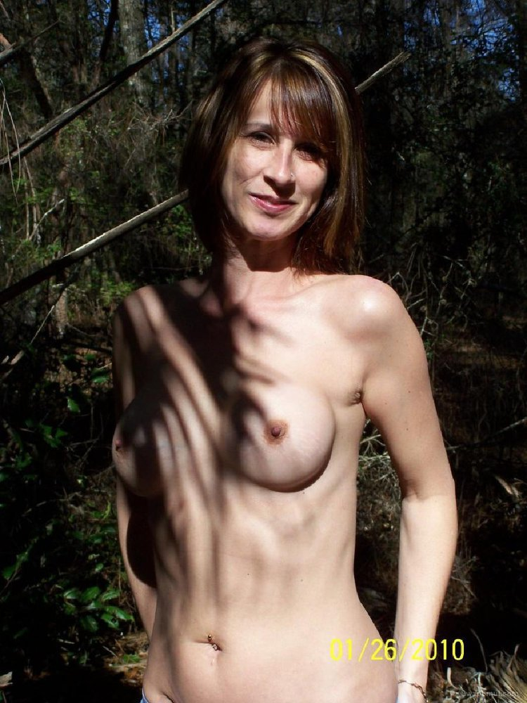 Busty wife Alena outdoors posing for sexy topless photos