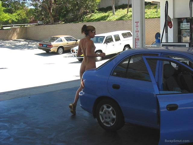 Girl in gas station showing her body naked filling up and paying