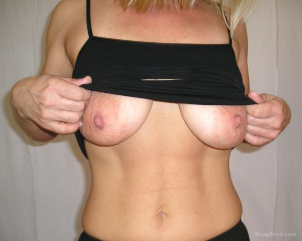 My sexy blonde wife loves showing off her big round tits