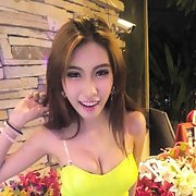Gorgeous Thai showing off her spectacular Boobs and she looks happy