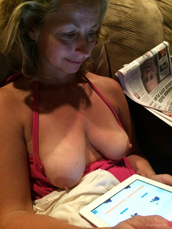 Mature blonde with huge tits, busty slut exposing her breasts online
