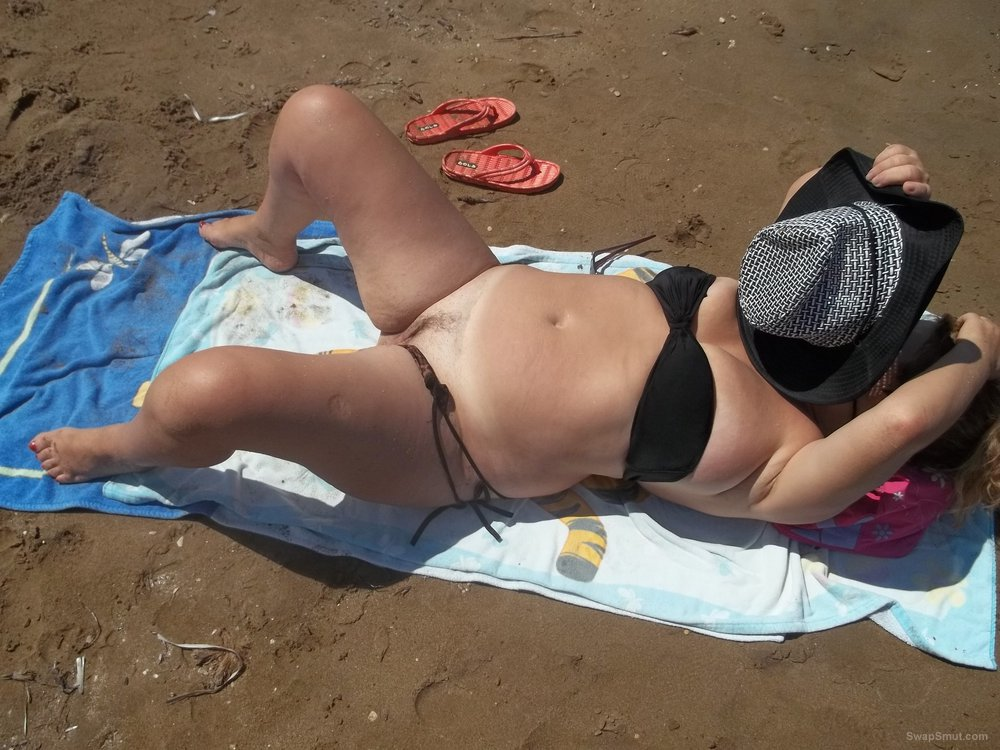 Sexy wife and teacher sunbathing on the beach revealing vagina