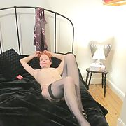 Redheaded fuck slut on the bed