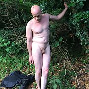 Posing small penis outdoors forest