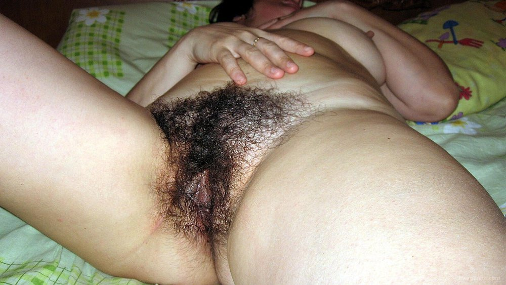 My wife shows her sexy hairy wet cunt lips spread apart showing pink