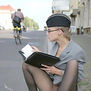 Amazing lovely blonde in pantyhose spreads outdoors