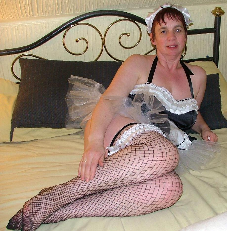 Wife posing for pics dressed in a sexy french maid outfit