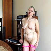 A woman Anna in stockings shows herself in the apartment