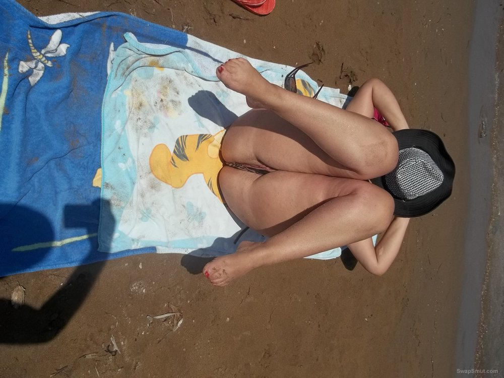 I am a sexy wife 32 years old teacher sunbathing nude on the beach