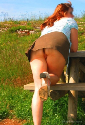 A very sexy and hot MILF posing just for you upskirt pics outdoors