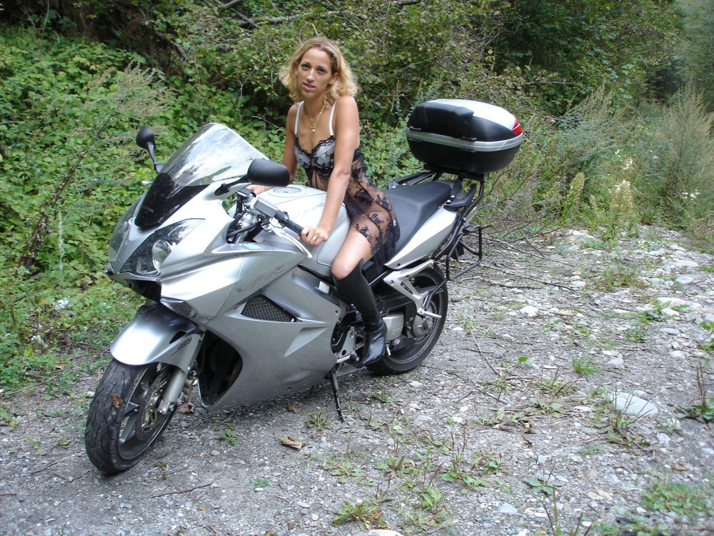 Naughty photos taken in woods on motorbike wearing next to nothing