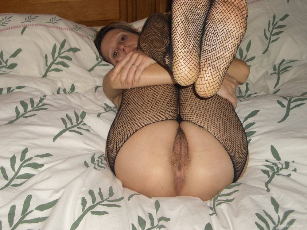 Sexy swinger wife posing for all to see wearing fishnet stocking