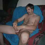 Male nudity having fun with an adult sex toy at home