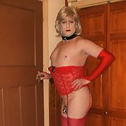 Rachel in red lacey basque, stockings and heels and in chastity