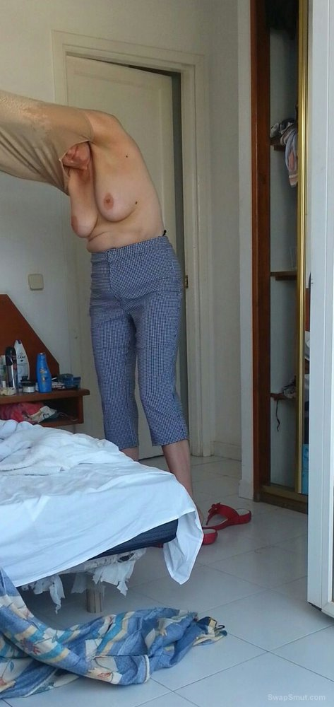 Some of the wife's tits and big nipples while dressing in the morning