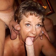 Big tit granny playing with cock and dildo