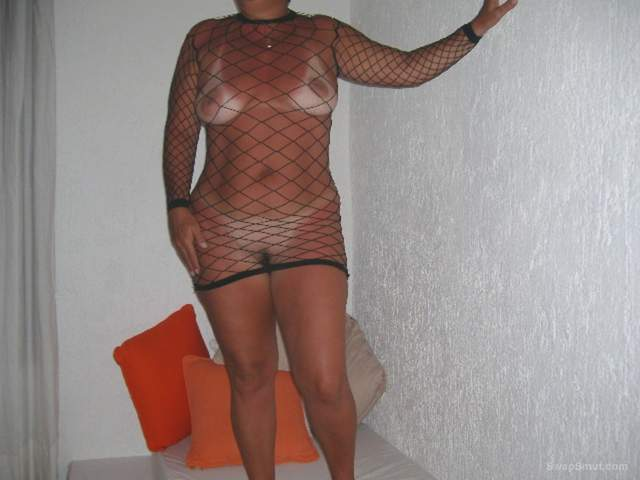Xaviera Black net dress showing tan lines