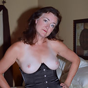 Big breast mature wife in stockings and heels
