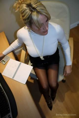 Busty Milf wearing black stockings in the office