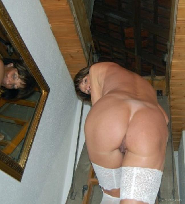 mature MILF mess around the house in stockings