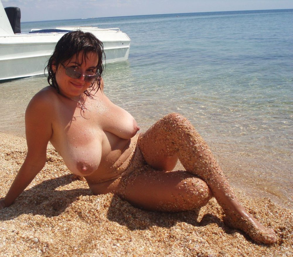 Stunning wife posing nude while on holiday body covered with sand