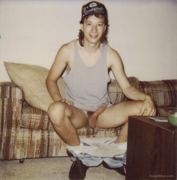 Twink Jean-Luc Nude and erect sitting on the couch with a hardon