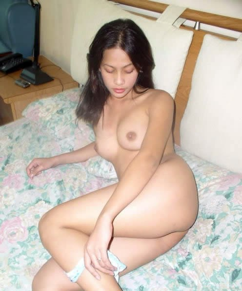 Asian beauty waiting on the bed removing her panties to show you