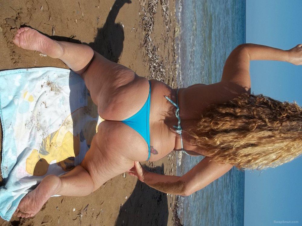 32 year old milf on the beach wearing bright blue bikini