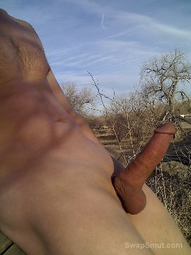 My cock covered in cum after wanking outdoors