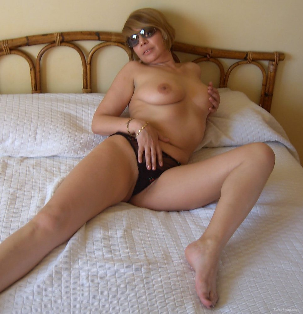 Another sexy friend posing on my bed in just her panties