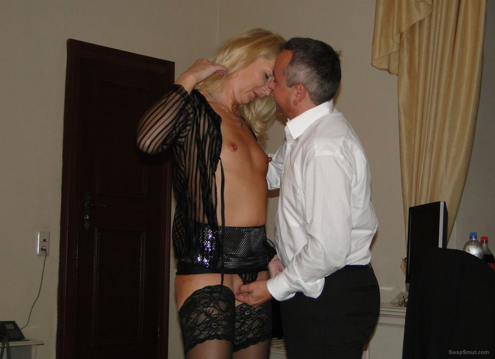Mature blonde wife enjoying sex with another man