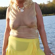 Summertime at the lake with my yellow dress flashing for you be kind please