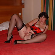 Clare in stockings and red suspenders part 2