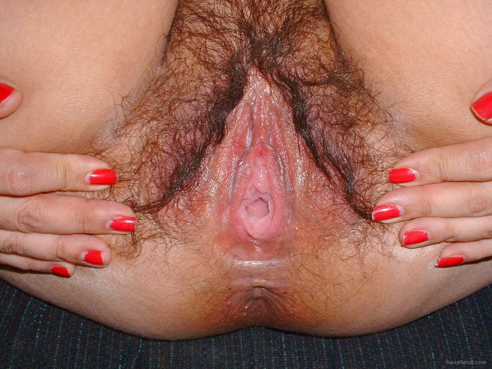 Spreading my wet hairy pussy wide open look at my horny photos