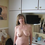 Mature slut stripping for a cock