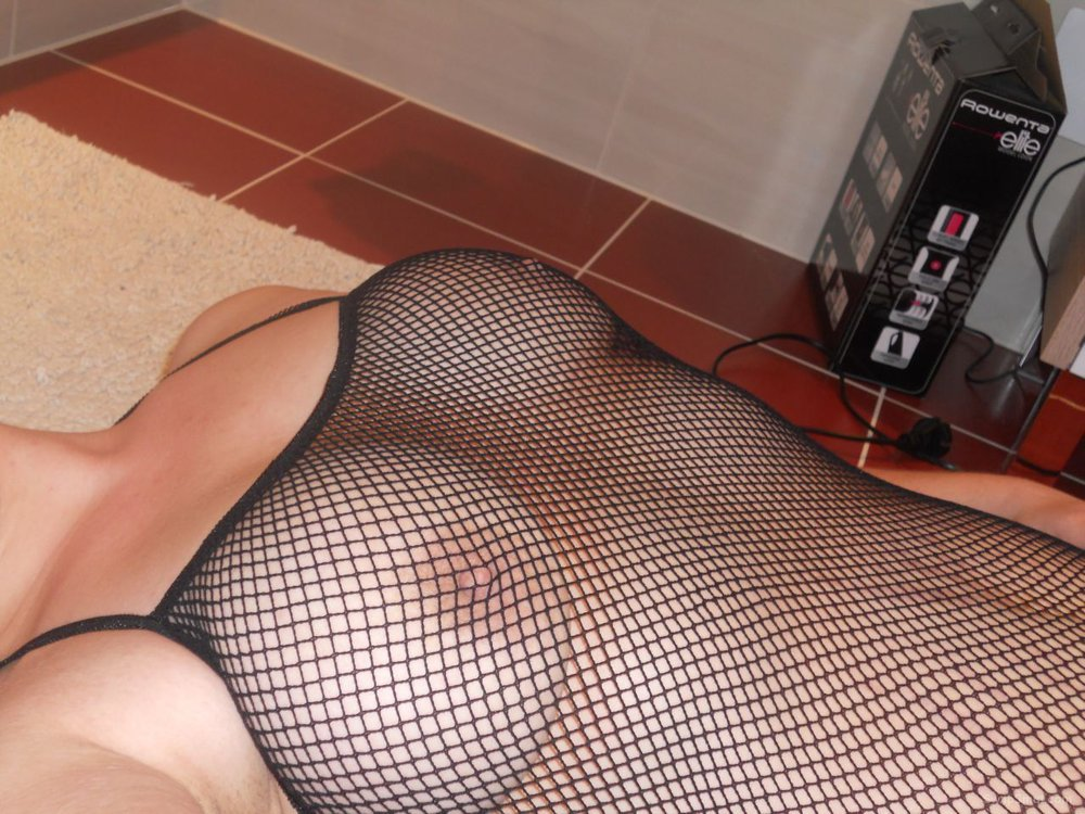 BBW Dani in a sexy catsuit teasing her pussy on the floor adult erotic