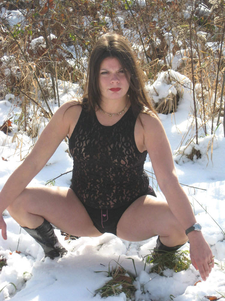 Snow Bunny outdoors in the snow on a cold after noon flashing