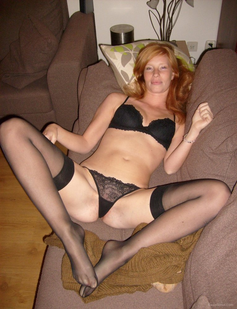 A beautiful redhead in a beautiful position