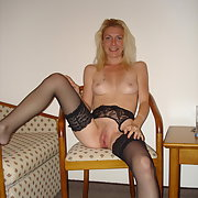 Blonde amateur posing for pics in lingerie pussy wet and shiny