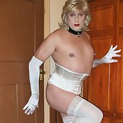 Pierced sissy Rachel in white basque, stockings and heels