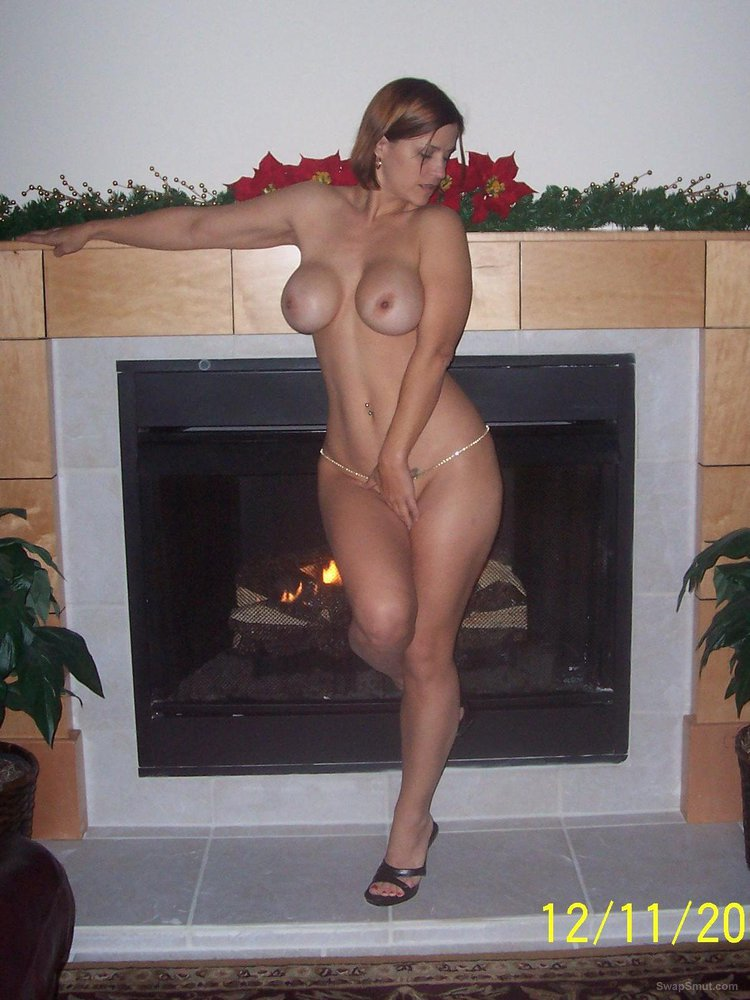 A very sexy bi wife canoodling with friend and hubby in front of fire