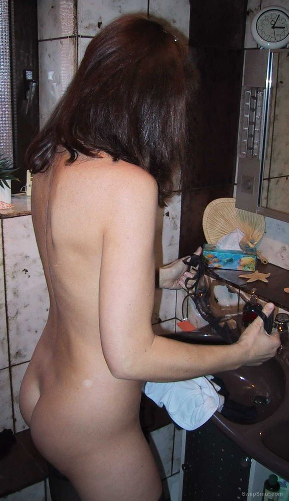 German girl Bettina posing in the bathroom hairy pussy
